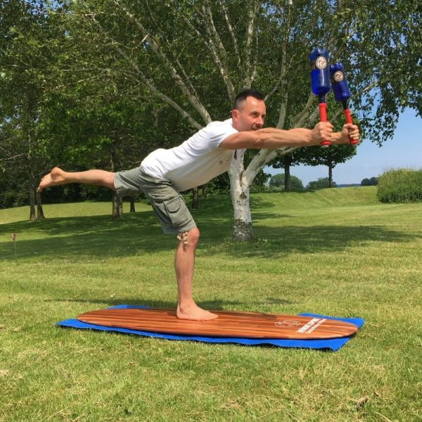 Indian clubs workout on yoga board